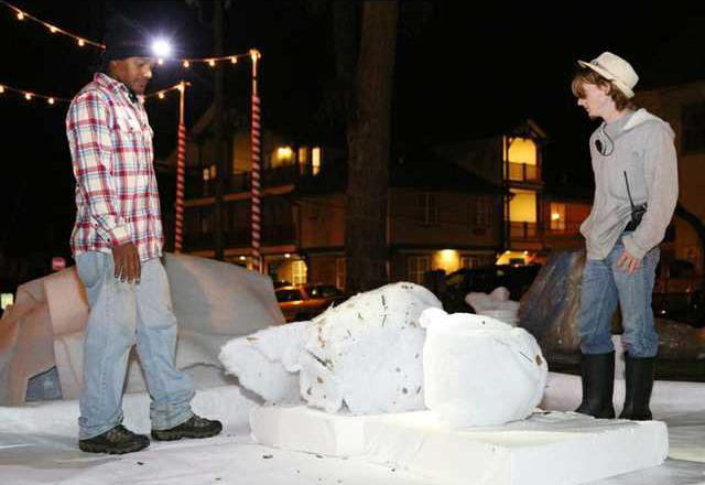 jeremy fanning and gill cureau special effects technicians work on making fake snowball piles oct 12 as the crew prepares to film a scene of christmas - Where Was The Christmas Card Filmed