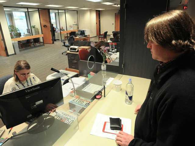 Tag Office Busy As Some Opt Into New Car Tax Gainesville Times