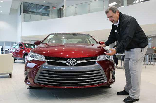 Don Sims, A Sales Consultant At Milton Martin Toyota, Shows Off A 2015  Toyota Camry In The Showroom Of The Toyota Dealership In Oakwood On Friday.