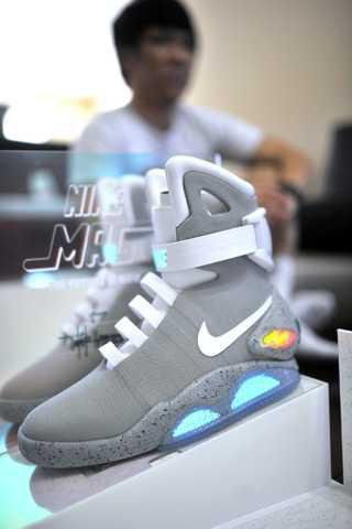 """27ab86092239 Gainesville resident Harry Do won a pair of the Nike Mag self-lacing shoes  from the 1989 film """"Back To The Future II."""" The shoes were designed by  Tinker ..."""