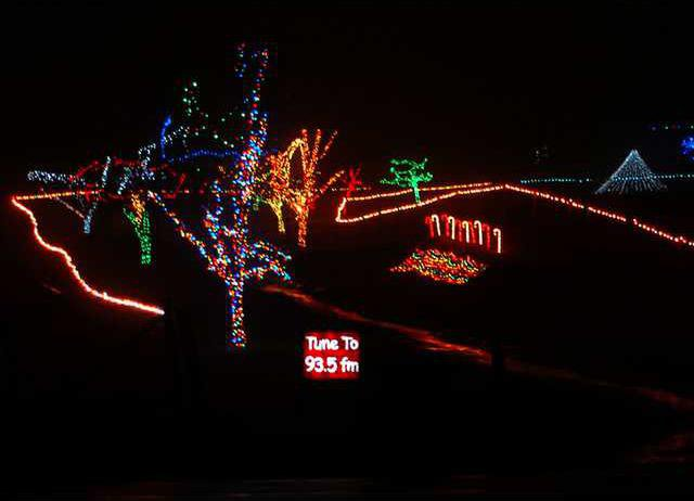 Christmas lights along Poplar Springs Road are in sync with a radio station  playing Christmas music. - Lighten Up This Holiday Season - Gainesville Times