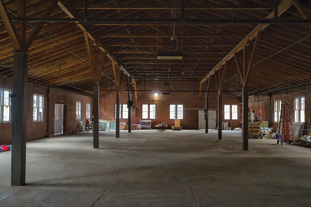 The empty space of the old Georgia Chair will soon be the home to copper stills for the Georgia Distillery Company. - photo by Scott Rogers & Distillery plans could change face of midtown Gainesville at ...